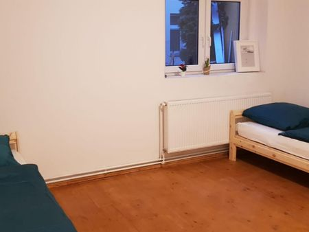 Bed in double bedroom in Spandau