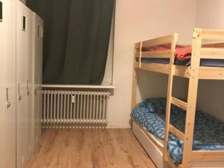 Bed in a triple bedroom, in Tiergarten