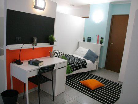 Bed in a spacious twin bedroom in San Salvario