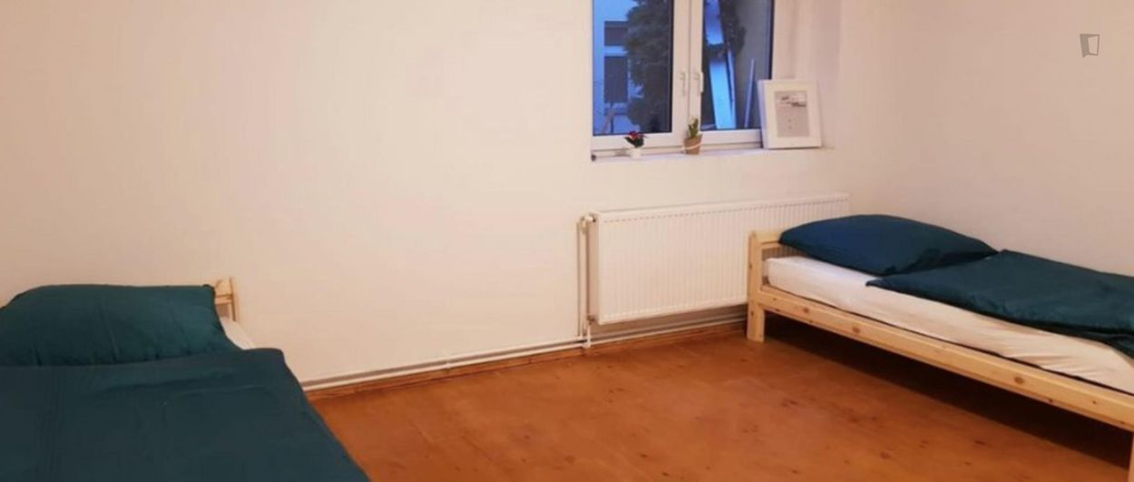 Bed in a twin bedroom, in Spandau