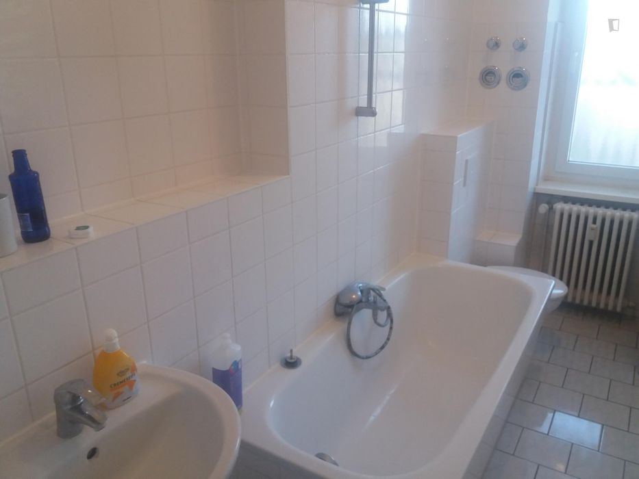 Amazing and practical single or double room in a 3 bedroom well lit apartment .