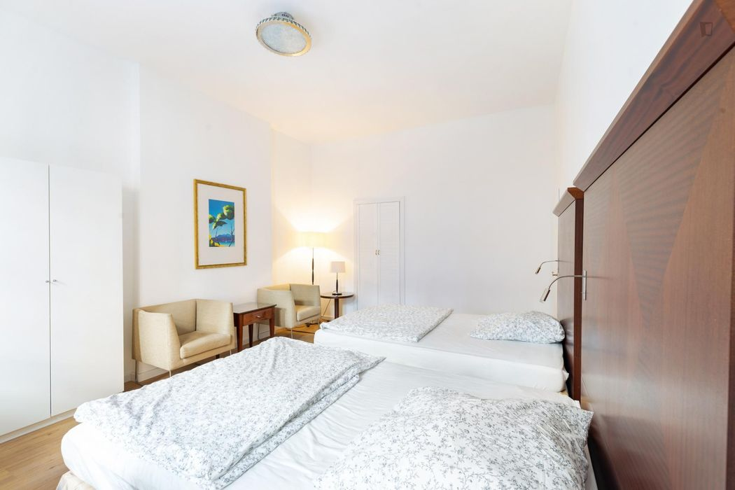 Bed in a homely twin bedroom, in Wedding