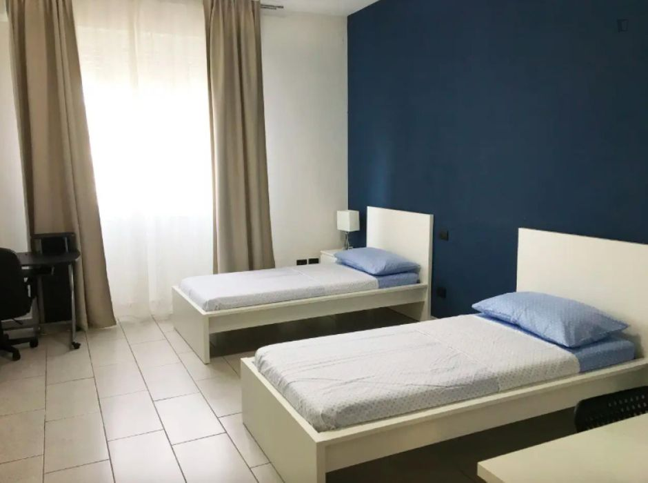 Cosy bed in a twin bedroom close to Mummu Academy