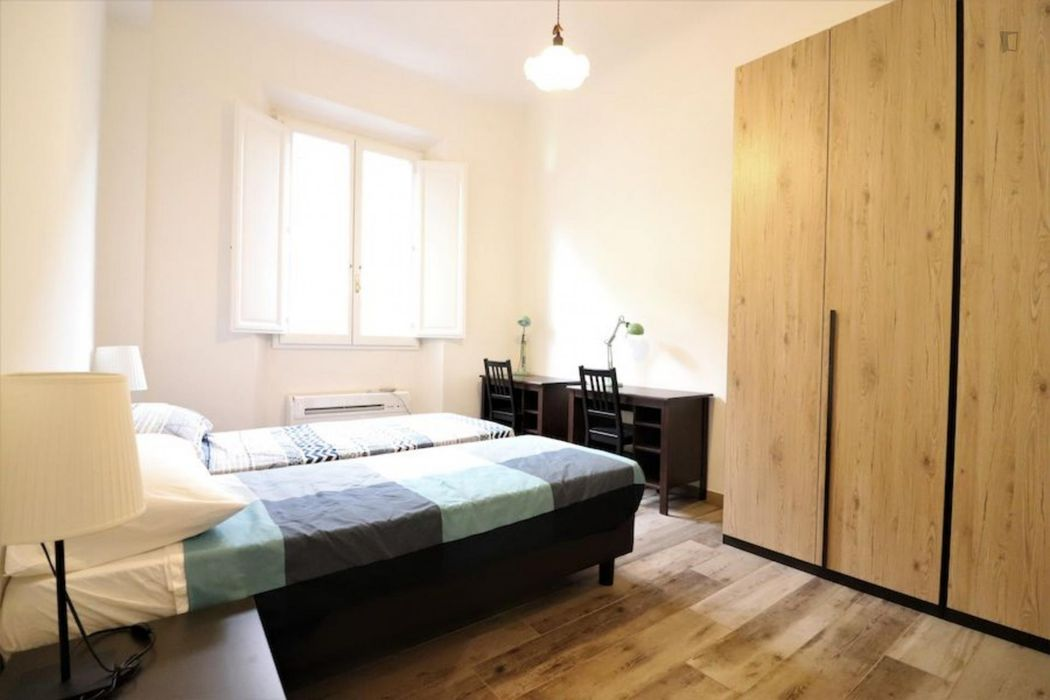 Bed in a twin bedroom in Florence city centre