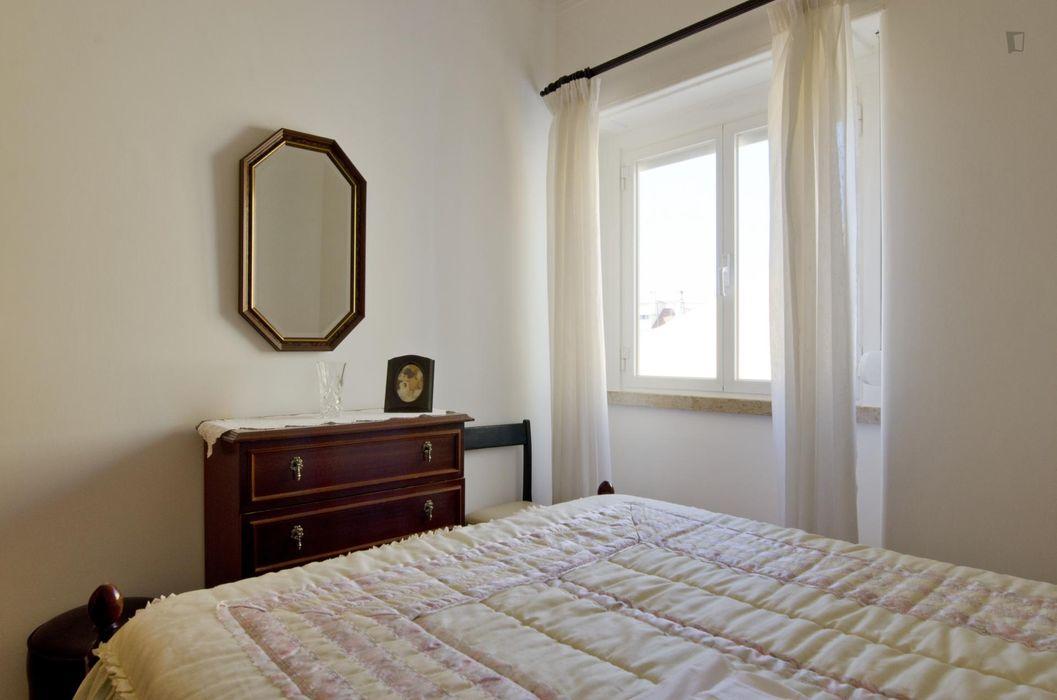Modest 2-bedroom flat close to the famous Palácio Nacional da Ajuda