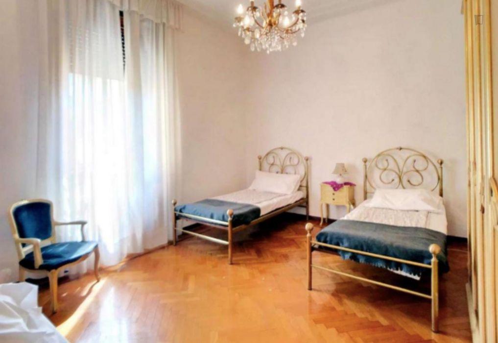 Bright bed in a shared apartment, in Porta Venezia neighbourhood