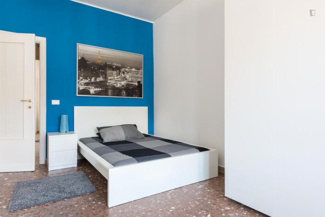 Modern double bedroom in a 4-bedroom apartment near Garbatella metro station