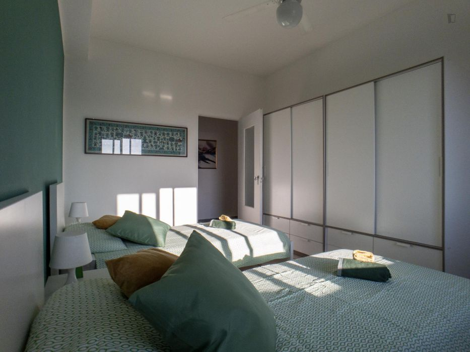 Bed in a twin bedroom close to Sesto Rondò metro station