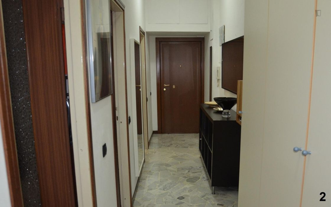 Bed in a twin bedroom not far from Porta Romana station