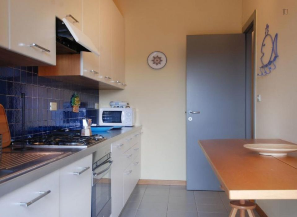 Colourful 1-bedroom apartment next to Amendola Fiera metro station