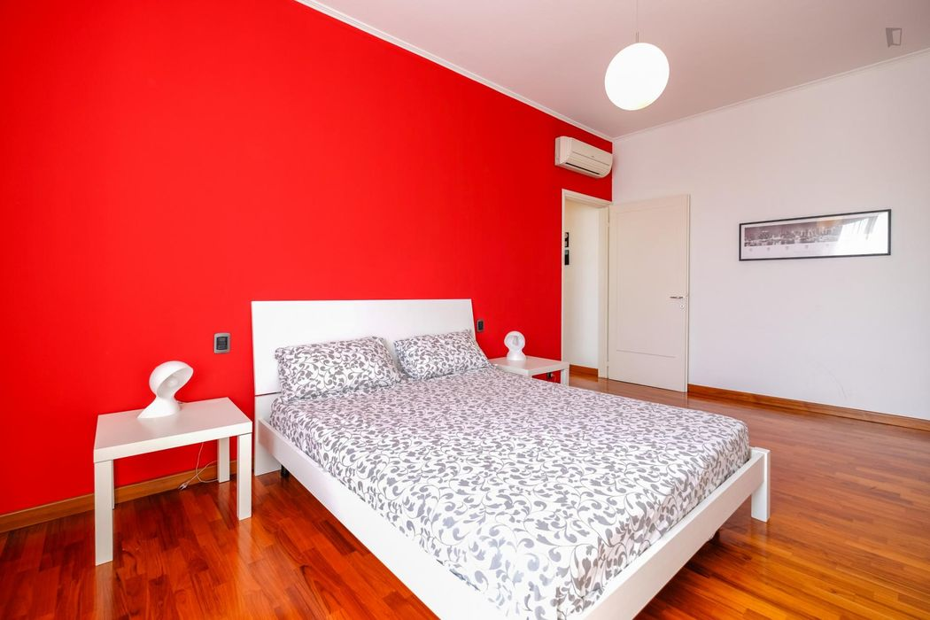 Colorful double bedroom near Bicocca university