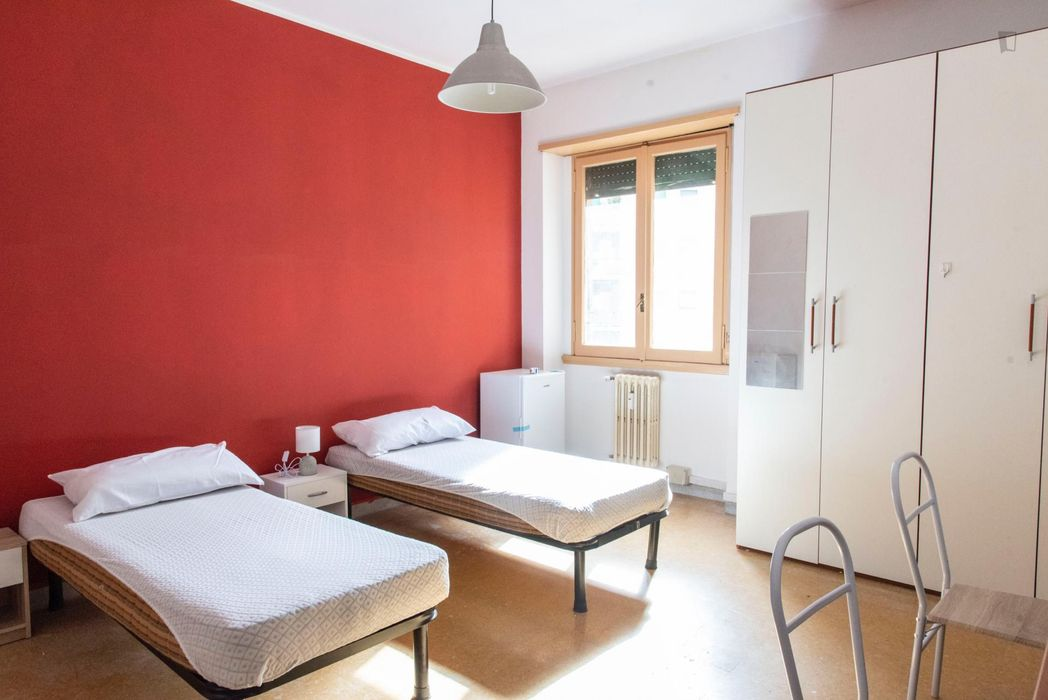 Bed in a twin bedroom, in a 3-bedroom apartment in Gianicolense