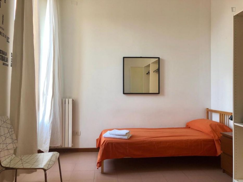 Bed in a twin bedroom, part of a 2-bedroom flat in Gratosoglio
