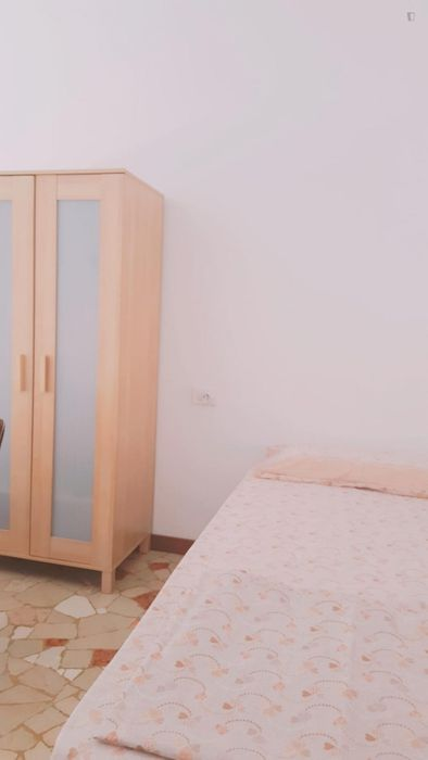 Bed in a twin bedroom close to Corvetto metro station