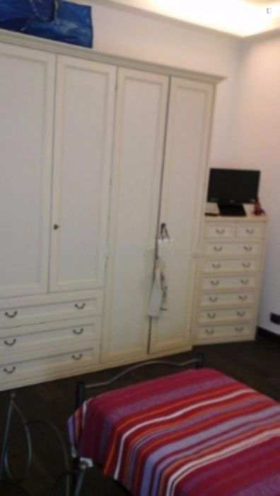 Bed in a cosy twin bedroom near Giulio Agricola metro station