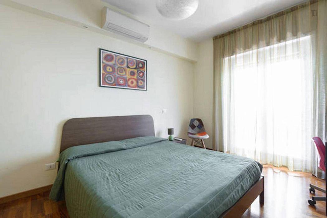Cosy double bedroom in the Quartiere XI Portuense area