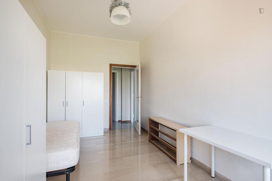 Airy bedroom in Primavalle neighbourhood