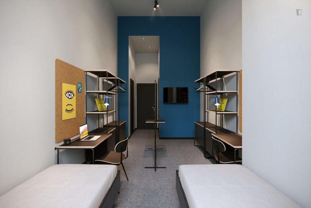 Spacious twin bedroom in a nice residence near Tiarini bus stop