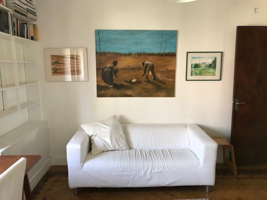 Double bedroom placed in a house in trendy Alcântara