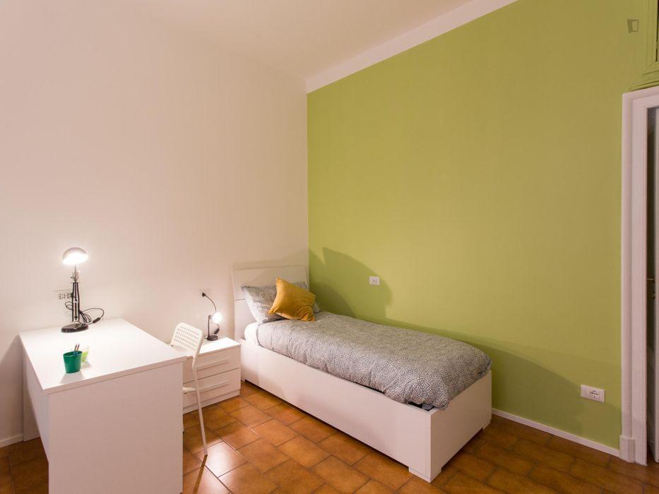 Bed in modern twin bedroom in in Zona Delle Regioni