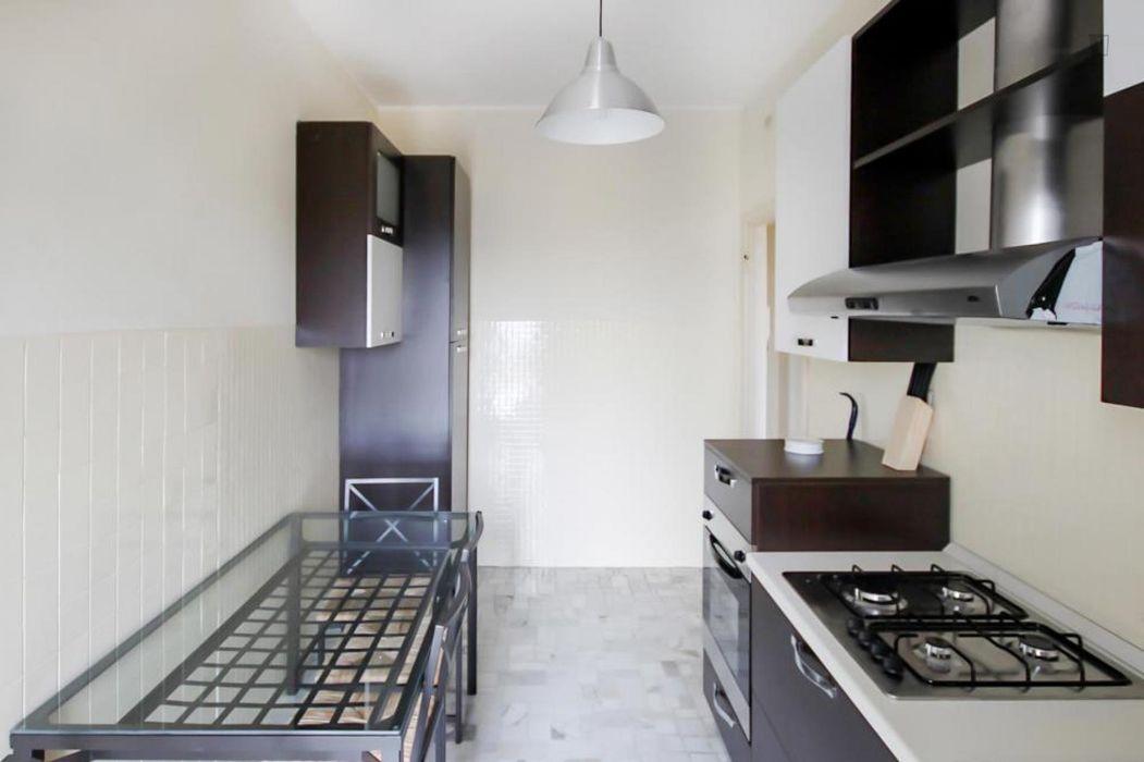 Elegant double bedroom in a 4-bedroom apartment near Parco Don Luigi Giussani