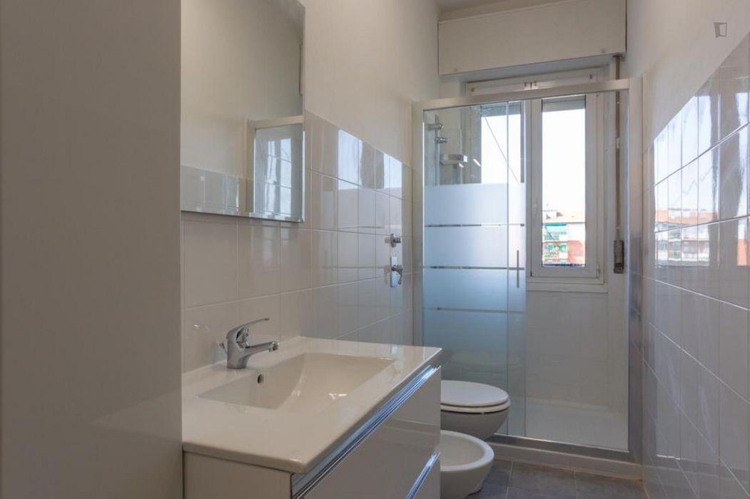 Cool twin bedroom in a 4-bedroom apartment near Primaticcio M1 metro station